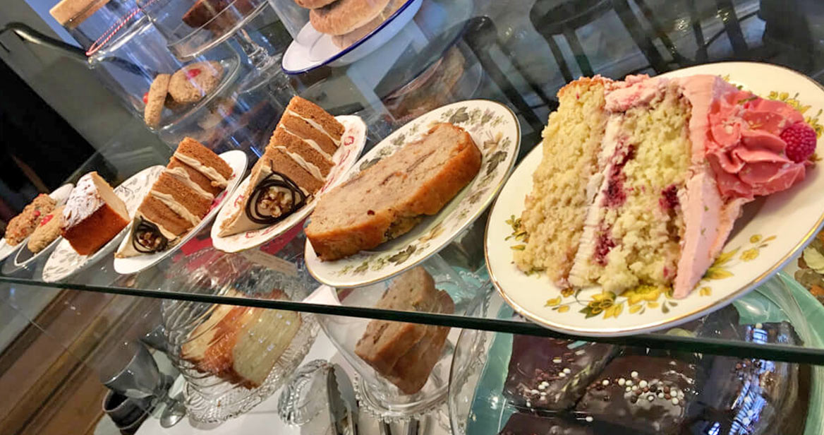 A display showing various colourful cakes