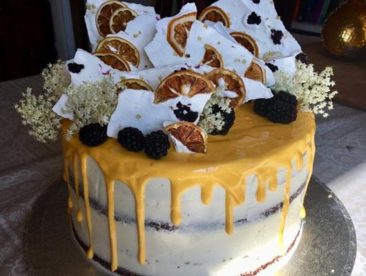 An orange shard naked cake